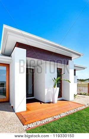 Solitary And Luxurious House Entrance On A Sunny Day With Blue Sky Background