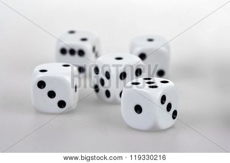 Five Dices On A White Table