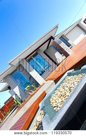 New Design Of A Modern House And Garden Including Stone Decoration With Wooden Yard