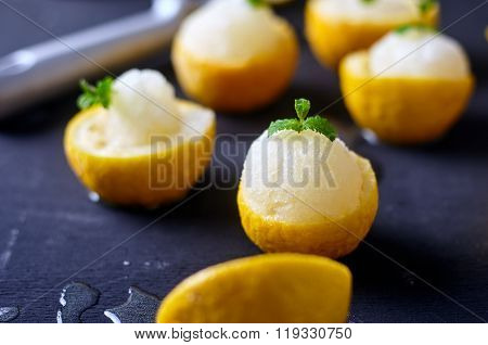 Lemon sorbet or ice cream inside fresh lemons