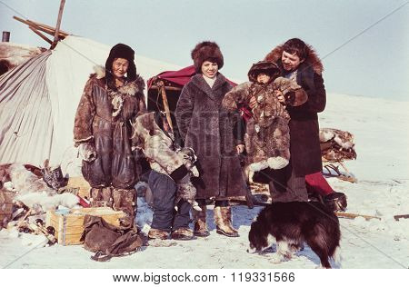 Two tourists (caucasian man and woman) visiting remote station of the indigenous people
