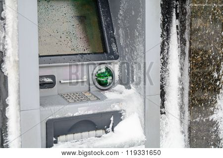 Atm Machine Covered With Snow. Functional Bank Atm Machine Covered With Ice And Snow. .