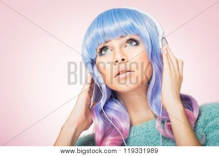 Gorgeous young woman with blue and pink hair and headphones