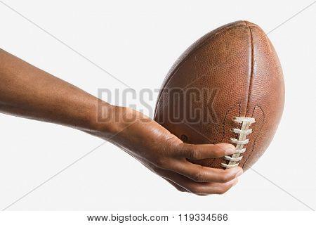Man holding American football