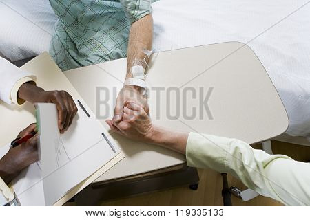 Patient with doctor and relative