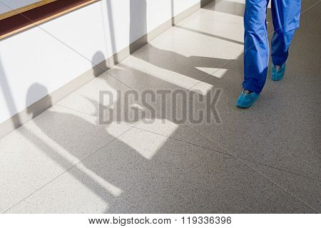 Surgeon walking down corridor