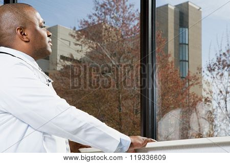 Doctor looking out of window