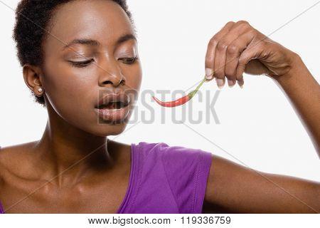 Woman holding chili pepper