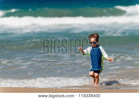 Little Boy Running On The Beach