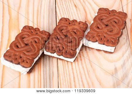coockies with zephyr layer on wooden background
