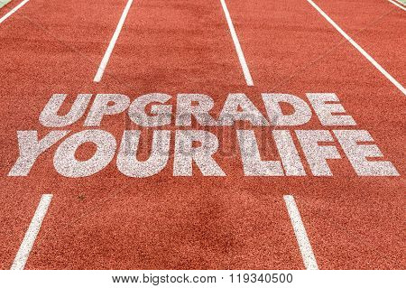 Upgrade Your Life written on running track