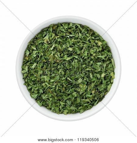 Dried Parsley Flakes In A Ceramic Bowl