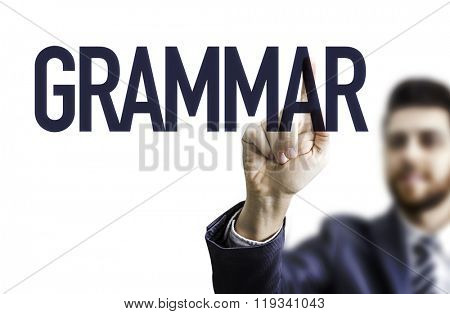 Business man pointing the text: Grammar