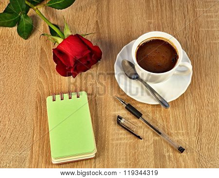 red rose, coffee, notebook