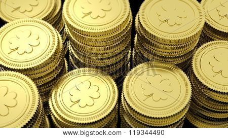 Stacks of golden coins with clover leaf background.