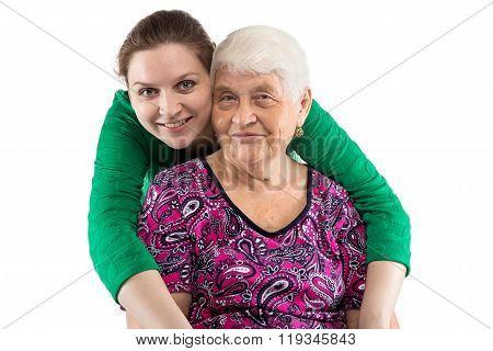 Hugging grandma and granddaughter