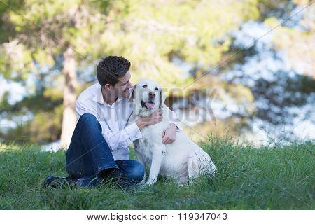Young Men Kissing His Senior Labrador Dog