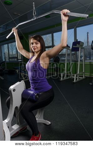 Beautiful muscular fit woman exercising