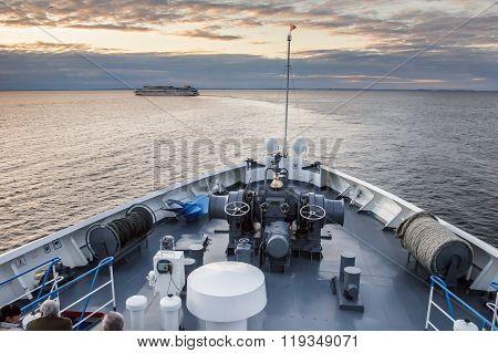 Nose of the ship sailing at sunset.