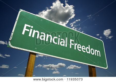 Financial Freedom Road Sign with dramatic clouds and sky.