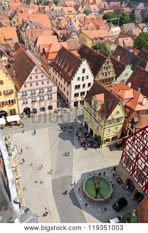 ROTHENBURG OB DER TAUBER GERMANY - AUGUST 10, 2015: Rothenburg ob der Tauber in Bavaria Germany. The Marktplatz square seen from the City Hall tower. Rothenburg is one of the best-preserved medieval towns in Europe part of the Romantic Road.