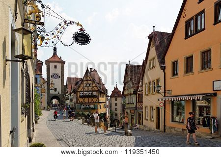 ROTHENBURG OB DER TAUBER GERMANY - AUGUST 10 2015: The Plonlein (Little Square) with the Siebers Tower on the left and Kobolzell Gate on the right one of the most photographed spots in the world.