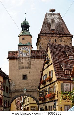 ROTHENBURG OB DER TAUBER GERMANY - AUGUST 10 2015: Markus Tower with Roder arch with its slim clock tower which were part of the town's first fortifications (1200).