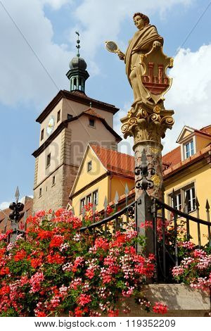 Rothenburg ob der Tauber in Germany. Seelbrunnen fountain on Chapel square. It embodies the Greek goddess Minerva the virgin goddess of wisdom and patroness of the city.