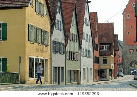DINKELSBUHL GERMANY - AUGUST 10 2015: Street with historic houses in the Dinkelsbuhl city center. Dinkelsbuhl is old Franconian town one of the best-preserved medieval urban complexes in Germany.