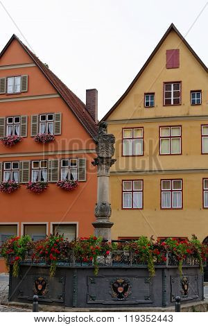 Founatain on Altrathausplatz in Dinkelsbuhl Germany. Dinkelsbuhl is old Franconian town one of the best-preserved medieval urban complexes in Germany.