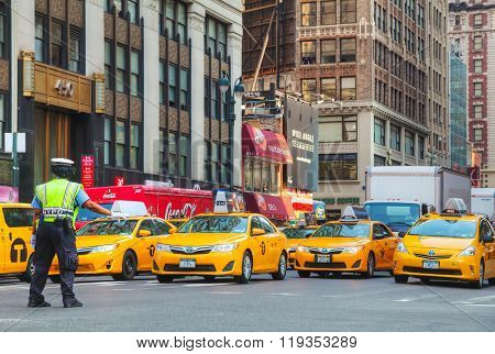 Yellow Taxis At The Street In New York