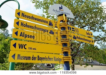SCHWANGAU GERMANY - AUGUST 11 2015: Signpost in Schwanhau showing the way to the main tourist attractions.