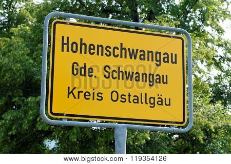 Hohenschwangau village yellow signpost in Bavaria, Germany.