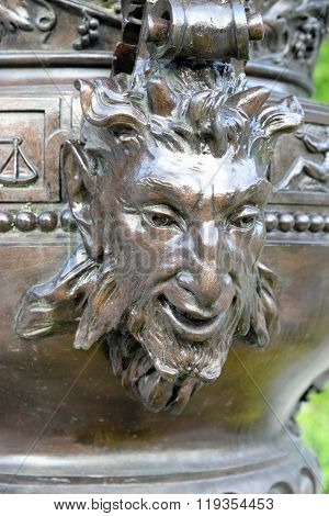 Linderhof palace in the Bavarian Alps. Detail on one of the cast zinc vases decorating the large basin in front of the palace.