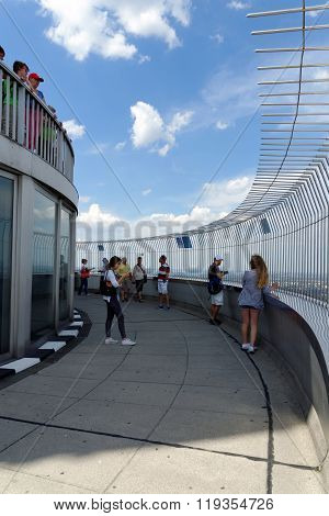MUNICH GERMANY - AUGUST 4 2015: Unidentified people are enjoying a great view of Munich from the 291 m high tower (Olympiaturm) in the Park.