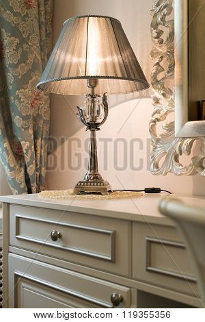 Interior luxury apartment detail room dresser and table lamp