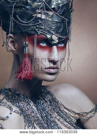 Woman in headwear from metal