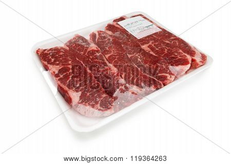 Fresh red meat packed in a poly bag.