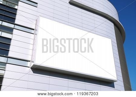 A large blank urban billboard with copy space