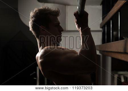 Bodybuilder Doing Pull Ups Exercises For Biceps