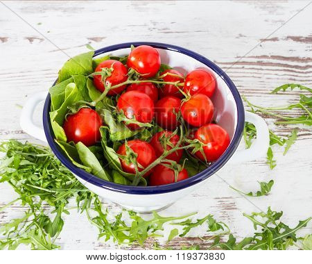 Closeup Of Cherry Tomatoes, Eruca Sativa, Rucola, Fresh Green Salad Leaves, Copyspace Background  Is