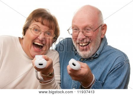 Happy Senior Couple Play Video Game with Remote Controls.