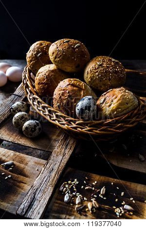 Easter Eggs With Kaiser Rolls And Sesame Seeds On Retro Crate