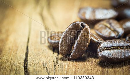 Coffee Beans Texture On The Wood Background,selective Focus,vintage Toning