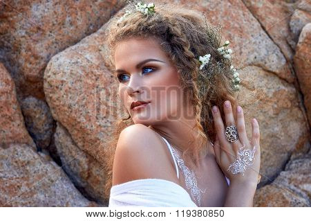 Pretty Curly Woman Portrait With Flowers In Head, Stone Garden