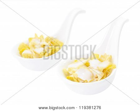 Corn Flake With Milk In Spoon