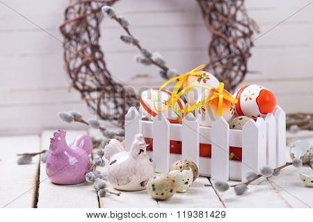 Decorative  Easter Eggs In Box, Hens  And  Willow  Branches On Wooden Background.