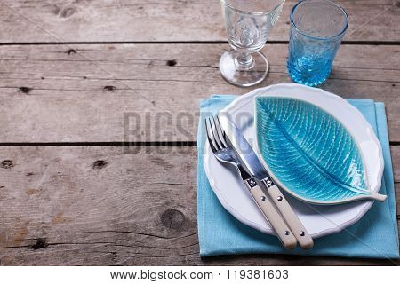 Summer  Table Setting. Decorative Plate In Form Of Leaf, Knife And Fork On White Plate On Vintage Wo