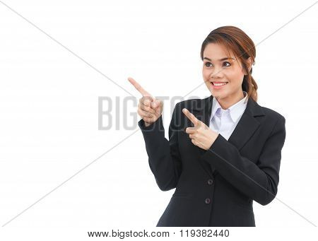 Asian Business Woman Pointing At Copyspace Isolated On White Background