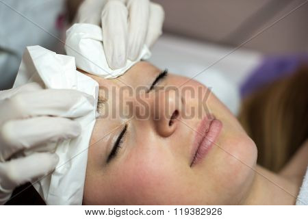 Young Woman Receiving Beauty Face Therapy Of Cleaning Pimple, Acne.